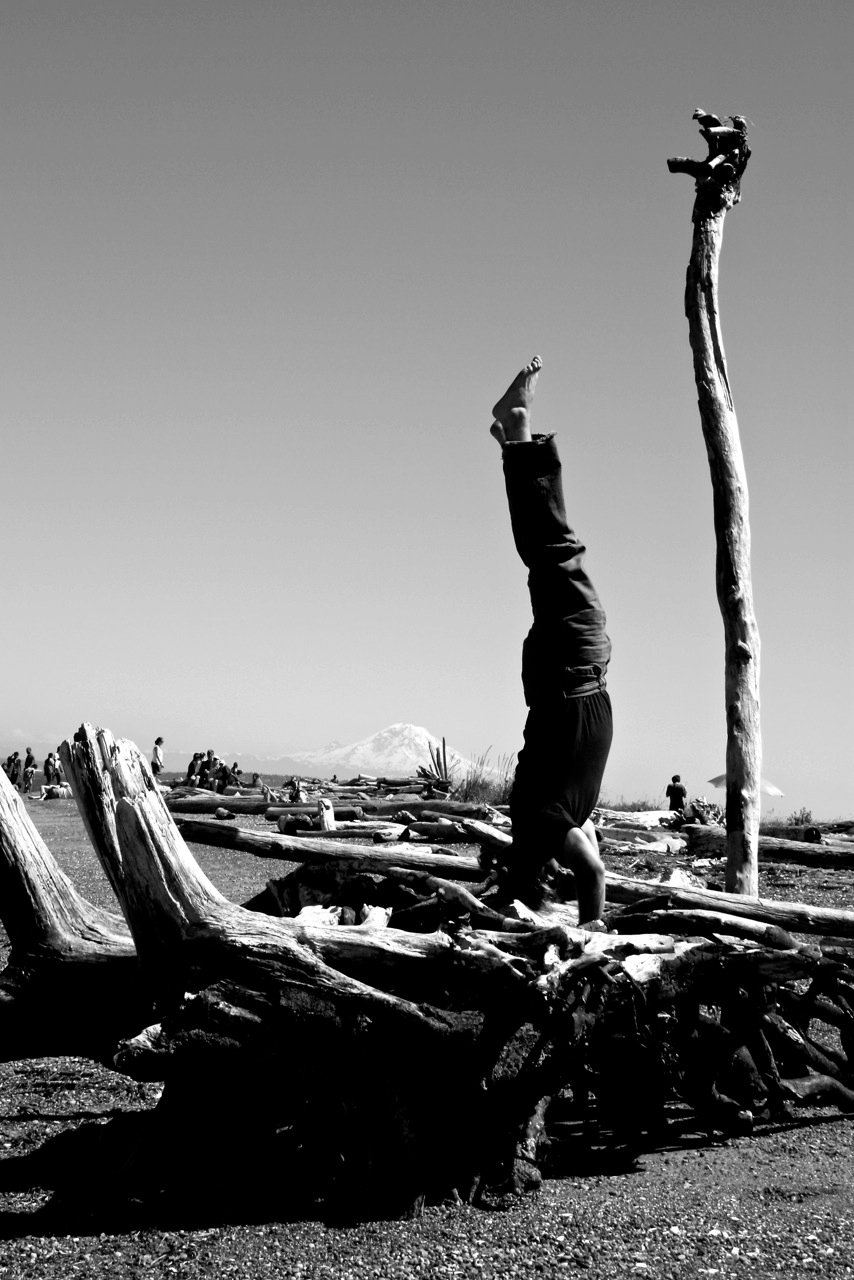 Marc Hordon performing a headstand in the wilderness